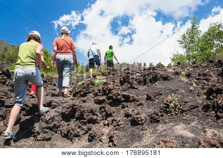 Tourists Climb To Old Crater Of Etna Volcano