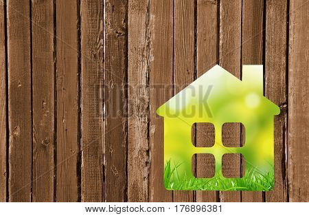 Small House On A Wooden Wall