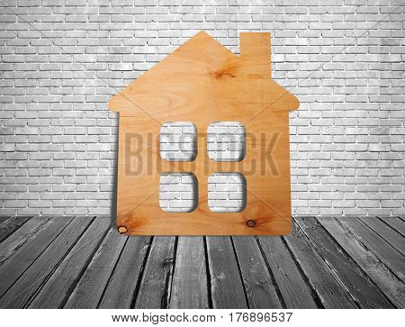 Small house in the room on the wooden floor