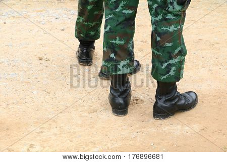 Army combat uniform soldier on the ground.