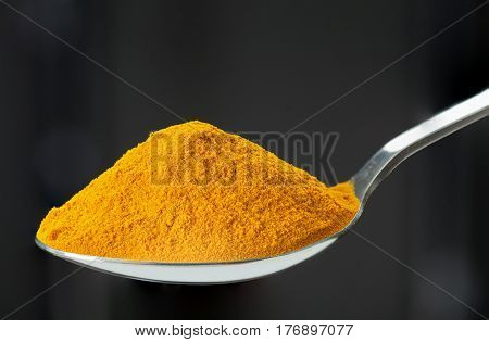 Spoon Of Ground, Powder Turmeric