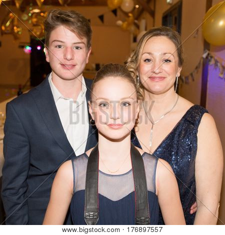 Separated Family With Mother Son And Daughter In Party
