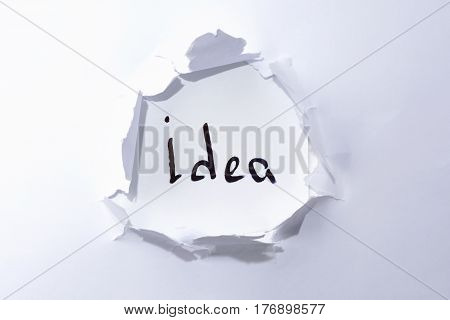 Idea On White Background In A Paper Hole