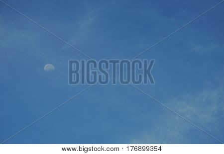 moon on the clear sky in daytime