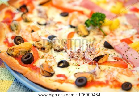 Sea food pizza and hawaiian closeup shot.