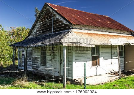 Old Abandoned Home With Rusty Sagging Roof