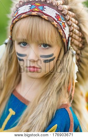 Beautiful Young Girl In The Image Of An Indian With A Roucche On Her Head