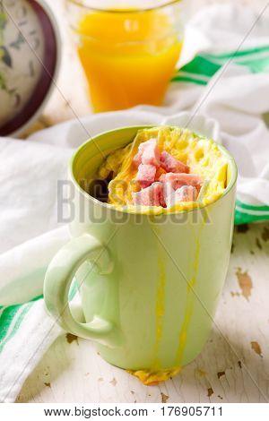 mug omelet in microwave . selective focus