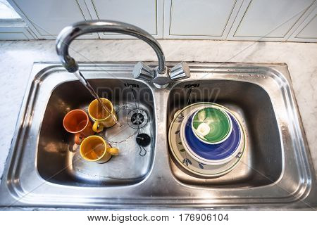 Washing Of Dirty Cups In Kitchen Sink