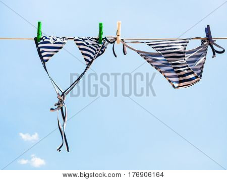 Striped Swimsuit Is Dried On The Clothesline