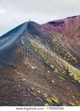 People On Range Between Craters On Mount Etna