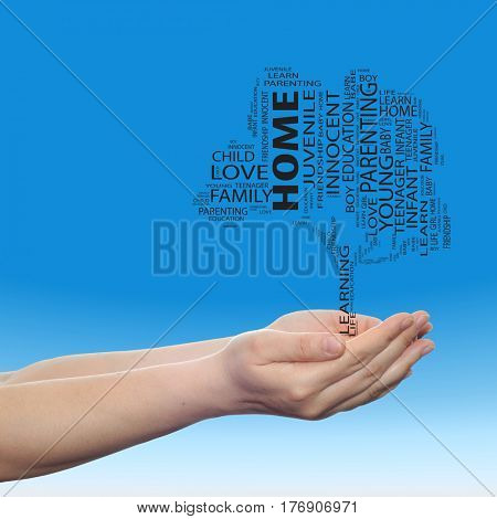 Concept or conceptual black education text word cloud or tagcloud as a tree on man or woman hand on blue sky  background