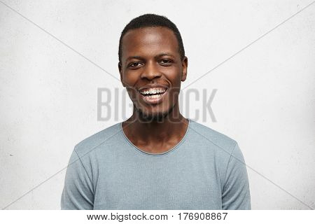 People And Lifestyle Concept. Portrait Of Attractive Young African Male In Good Mood, Wearing Casual