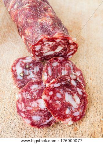 Sliced Italian Salami On Wooden Board
