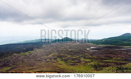 Low Cloudy Sky Over Lava Fields On Mount Etna