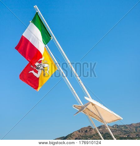 Italian And Sicilian Flags And Blue Sky