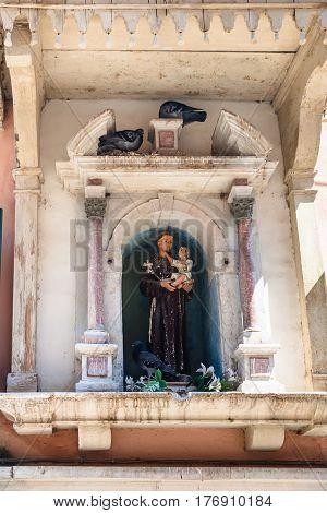 Sculpture Of A Saint In Urban House In Venice