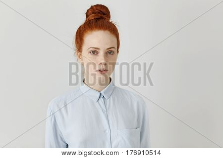 People And Lifestyle Concept. Charming Student Girl With Ginger Hair Knot Wearing Formal Shirt Looki