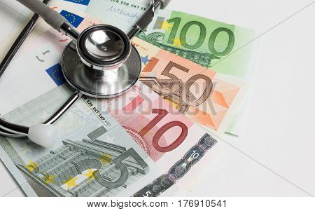 European Currency With Doctor Stethoscope. Medical And Money For Social Insurance Or Social Security