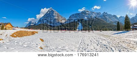 Panoramic view of the Pista Nera on a sunny winter afternoon, Sappada Italy.