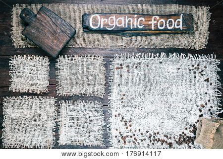 Rustic style template for food and drink industry. Burlap frames on dark wood background. Wooden cutting board and signboard with text 'Organic food' as title bar