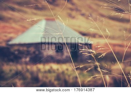 A Scottish Bothy or Hut Or Cottage In The Winter With Grass In The Foreground