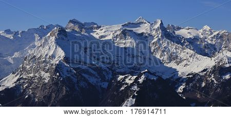 Brunnistock and Uri Rotstock. Snow covered mountains in Central Switzerland.