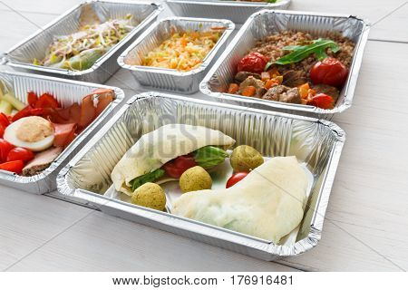 Healthy food in foil boxes. Meat with vegetables. Restaurant dishes delivery, lunch for diet, daily ration