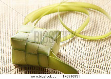 Close up of the ketupat on the weaving matt