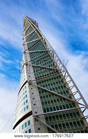 MALMO SWEDEN - MARCH 07 2017: Malmo Turning Torso city landmark designed by Spanish architect Santiago Calatrava in Neo-futuristic architectural style is largest building in Skane area of Sweden