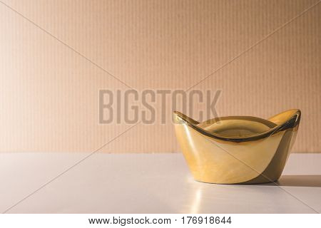 Chinese gold ingots on the table Free space for text