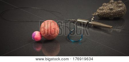 Carp Hook Boilies On The Dark Background . Closeup .