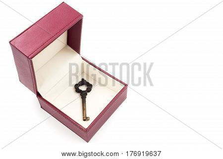 Metal key in red gift box on white background.