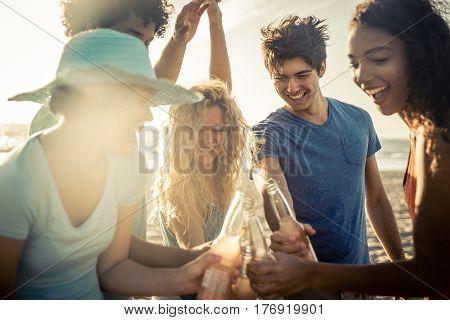 Group of friends having fun on the seashore