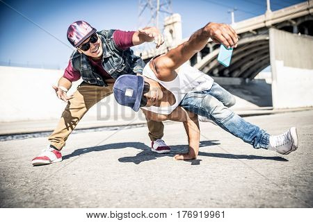 Breakdancers performing in a water duct and taking a selfie