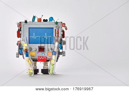 Cardiogram monitor heartbeat line on blue display cardiograph. Robot character with clinic pulse test graphic, set of colorful pills drugs in arms. Gray background copy space