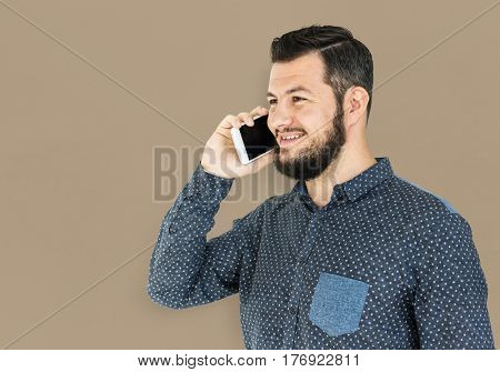 Man standing and using phone to pose for photoshoot  poster