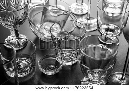 Clean different glasses on gray background. Horizontal