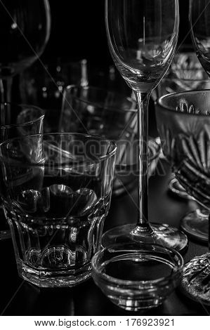 Clean different glasses on dark background. vertical