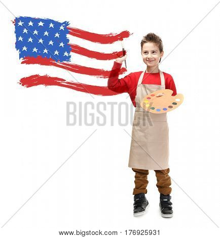 Little boy drawing USA flag on white background