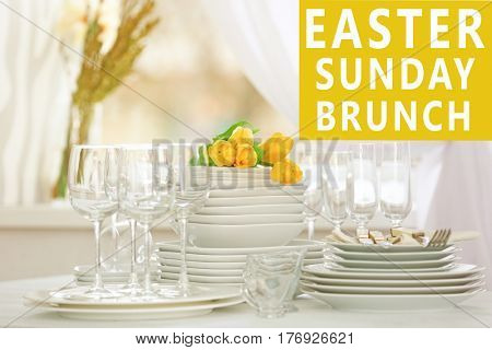 Text EASTER SUNDAY BRUNCH on background. Clean dishware on table
