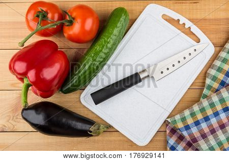 Different Vegetables, Cutting Board And Knife On Table