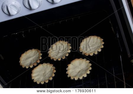 Cooking Cakes. Ready Cakes In Baking Molds. Stand On The Grate, Taken Out Of The Oven.