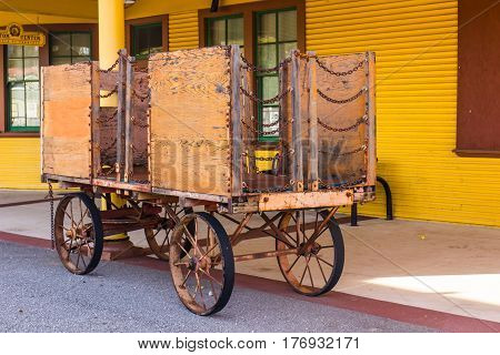 Vintage Plywood & Chain Luggage Cart At Old Train Station