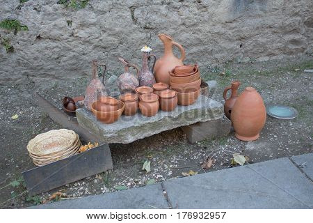 Handmade clay pots. Georgian people's handmade jars and drinking horn. Souveniers for tourists