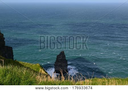 Large towering rock formation off the Cliffs of Moher in Ireland.
