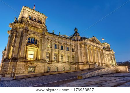 The frontside of the Reichstag in Berlin at night