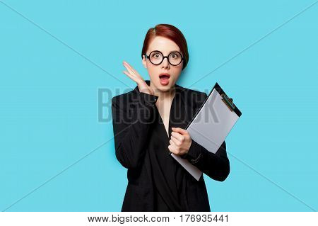 Beautiful Surprised Young Woman With Clipboard On The Wonderful Blue Background
