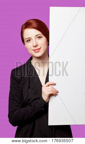 Beautiful Young Woman With Big Empty Poster On The Wonderful Purple Background