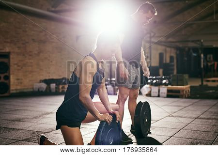 Young Sportive Adults In Sportswear On Workout